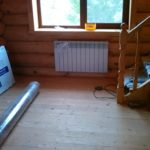Установка радиатора у лестницы