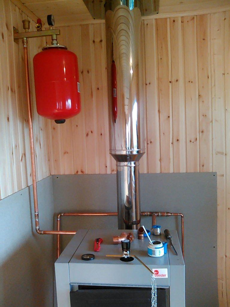 Установка дровяного котла отопления